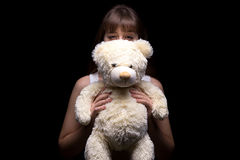 Cunning teenage girl with teddy bear Stock Photography