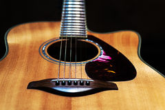 Cuntry-style acoustic guitar. In black background Stock Photography