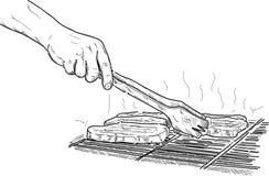 Cuocere una bistecca alla griglia Fotografia Stock Libera da Diritti