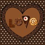 Cuocia le merci ed il dessert nella parola di forma di amore Immagini Stock Libere da Diritti