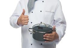 cuoco con la pentola che mostra i pollici su Fotografia Stock