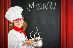 Cuoco del cuoco unico del bambino Concetto di affari di ristorante Fotografia Stock