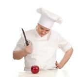 Cuoco femminile grasso arrabbiato con la mela e la lama rosse Immagini Stock