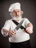 Cuoco unico anziano scontroso immagini stock