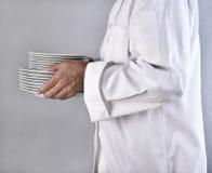 Cuoco unico Carrying Plates Immagini Stock Libere da Diritti