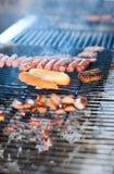 Cuoco unico che cucina carne Fotografia Stock