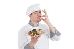 Cuoco unico che fa gesto GIUSTO dopo l'alimento raffinato Fotografie Stock