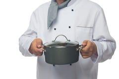 cuoco unico che tiene un coperchio del vaso Immagini Stock
