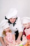 Cuoco unico con i bambini Immagini Stock