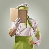Cuoco unico con il libro del cuoco Fotografia Stock