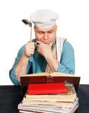 Cuoco unico con il libro di ricetta. fotografie stock