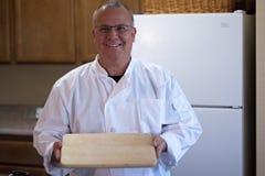 Cuoco unico con la scheda di taglio vuota Immagini Stock Libere da Diritti