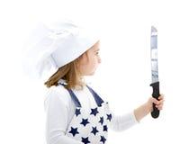Cuoco unico del cuoco della ragazza con la lama di cucina Fotografia Stock