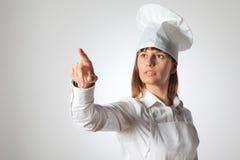 Cuoco unico della donna che indica lo spazio in bianco vuoto della copia isolato su fondo bianco Immagine Stock Libera da Diritti