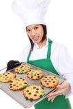 Cuoco unico della donna con i biscotti Immagine Stock