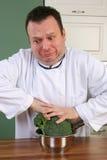 Cuoco unico e broccolo Immagine Stock