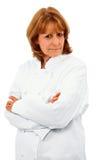 Cuoco unico femminile più anziano attraente con le armi attraversate Fotografia Stock Libera da Diritti