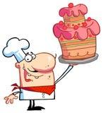 Cuoco unico fiero con la torta Fotografie Stock