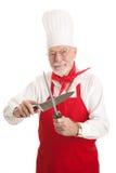 Cuoco unico maturo Sharpens Knife fotografia stock libera da diritti