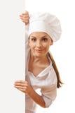 Cuoco unico, panettiere o cuoco della donna tenenti il segno del Libro Bianco Fotografia Stock