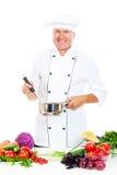 Cuoco unico in POT e cucchiaio uniformi della holding Fotografie Stock Libere da Diritti