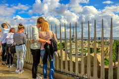 Couple in Paris. Paris, France - July 2, 2017: romantic couple looking Eiffel Tower in the distance from the top of Arc de Triomphe. Landmark in Paris skyline Royalty Free Stock Photography