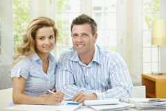 Cuople planning at home. Happy couple sitting at home, planning household financials Stock Photo