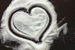 Cuore astratto dai granuli dello zucchero Immagini Stock