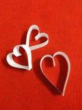 cuore bianco con fondo rosso Fotografie Stock