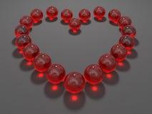 Cuore composto dalle sfere di vetro rosse Fotografie Stock Libere da Diritti