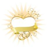 Cuore con gli anelli di cerimonia nuziale Immagine Stock