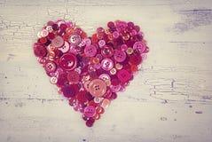 Cuore dai bottoni rossi Fotografie Stock