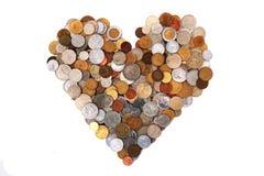 Cuore dalle monete del mondo Fotografie Stock Libere da Diritti