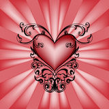 Cuore decorativo su priorità bassa rossa. Immagine Stock