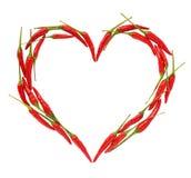 Cuore dei peperoni di peperoncino rosso Immagini Stock