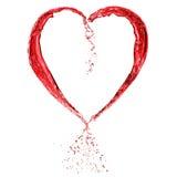 Cuore del biglietto di S. Valentino fatto di vino rosso Fotografia Stock