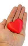Cuore del biglietto di S. Valentino in una mano Fotografie Stock