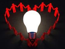 Cuore della gente e lampadina Fotografia Stock Libera da Diritti