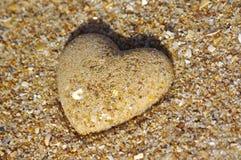 Cuore della sabbia immagine stock