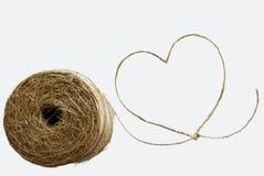 Cuore di amore alla corda del sisal Immagine Stock