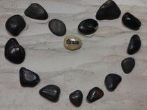 Cuore di pietra nero Fotografia Stock