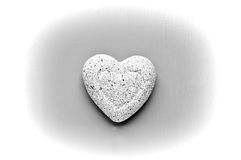 Cuore di pietra su grey Fotografia Stock Libera da Diritti