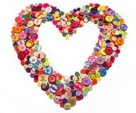 Cuore di vari bottoni di cucito, manopole Fotografie Stock