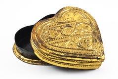 Cuore dorato su un fondo bianco Fotografia Stock