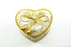 Cuore dorato su un fondo bianco Fotografie Stock Libere da Diritti