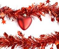 Cuore e decorazioni rosse della nappa Immagine Stock