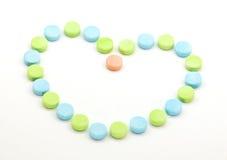 Cuore e pillole sani Fotografia Stock