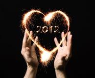 cuore ed il numero 2012 dal fuoco del Bengala Fotografie Stock Libere da Diritti