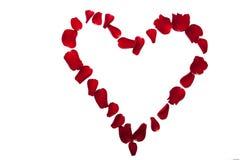 Cuore fatto dei petali di rosa rossa Fotografia Stock