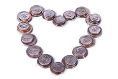 Cuore fatto delle monete Fotografia Stock